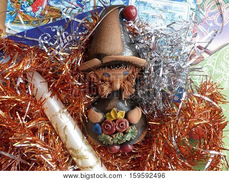 New Year's and Christmas. Gnome and Christmas candle. The interior of the New Year.