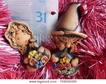 New Year's and Christmas. Father Frost helpers make out the received mail. The last leaf of a calendar - on December 31. The interior of the New