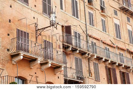Wall With Traditional Balconies In Sienna, Italy