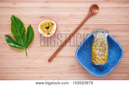 Fresh Passion Fruits  Juice In Bottle On Bamboo Background. Juicy Passion Fruits With  Passion Fruit
