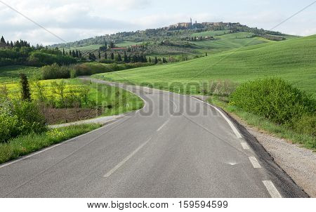 Winging Road And Town Of Pienza On The Hill. Tuscany, Italy