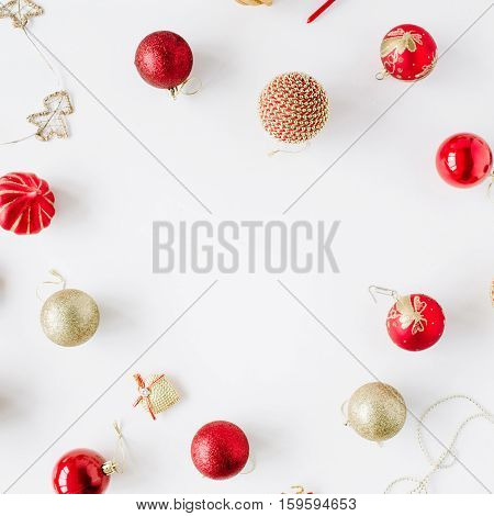 frame made of christmas decoration with christmas glass balls tinsel bow. christmas wallpaper. flat lay top view