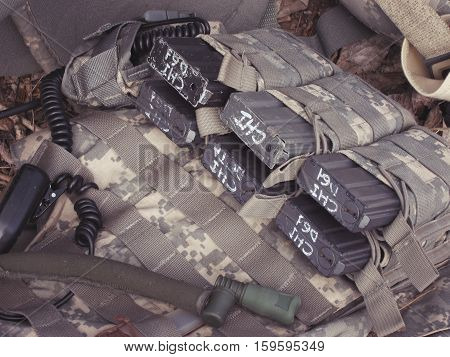 the tactical bulletproof vest with M4 magazines selective focus