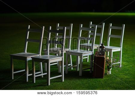 wedding lawn chairs the night  lawn, outdoor