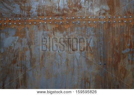 texture of rusty metal with rivets design