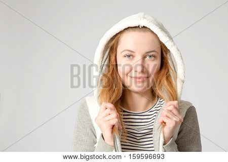 Young Cheerful Casual Caucasian Woman Wearing White Hoody Over Gray Background, Studio Shot. Copy Sp