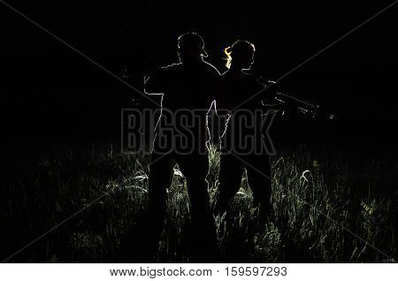 military silhouettes of a man and a woman