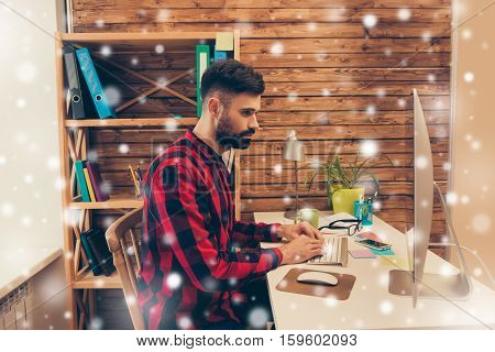 Side View Of Busy Bearded Man Working In Office Before Christmas