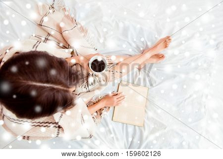 Top View Of Young Woman Reading Book  With Coffee On Xmas Holidays