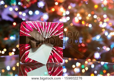 colourfull present box on christmas lights background