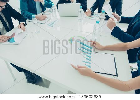 Close Up Of Young Managers Analyzing Diagramas On Business Meeting