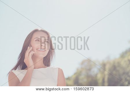 Portrait Of Cheerful Beautiful Woman Having Business Conversation