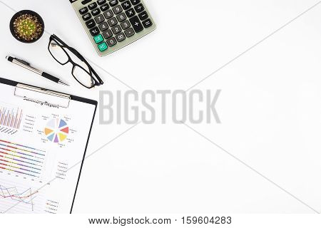 Modern White office desk table with analysis chart or graph pen eyeglass and calculator. Top view with copy space.Working desk table concept.