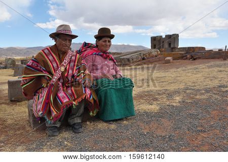 TIWANAKU BOLIVIA - August 26 2016: Unknown people with traditional costume on August 26 2016. Tiwanaku is a Pre-Columbian archaeological site in western Bolivia
