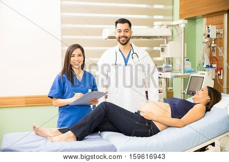 Hispanic Doctors Next To A Pregnant Woman