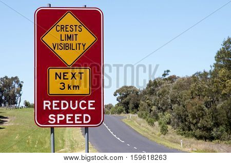 Reduce speed sign beside a country road, NSW, Australia