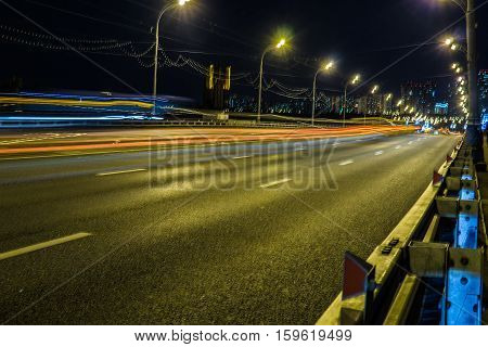 Blurred tail lights and traffic lights on road, Moscow