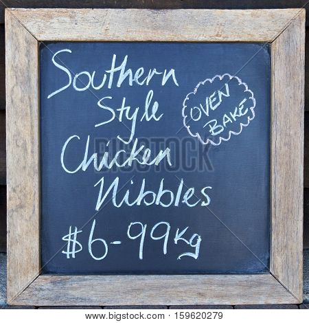 Chicken nibbles sign outside a butcher's shop, Australia