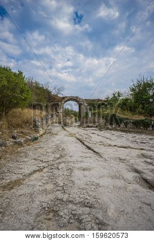 Ruins of medieval cave town Chufut-Kale, gate Orta-Kapu, Bakhchisaray, Crimea