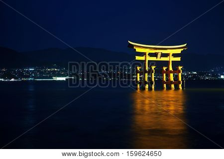 Beautiful Night View Of Torii Gate In Miyajima, Japan
