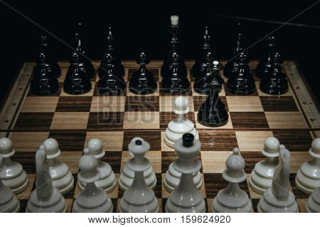 white pawn isolated on background chess pieces