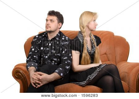 Happy adult couple on the sofa. Isolate on white poster