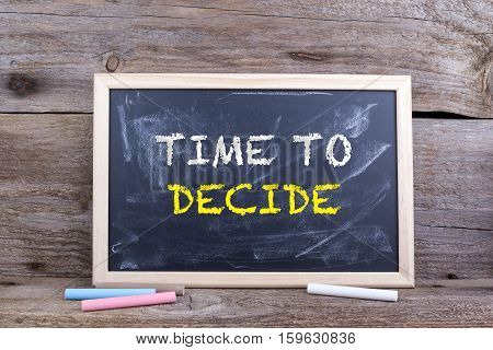 Time to  Decide. Text on blackboard, Old wooden background