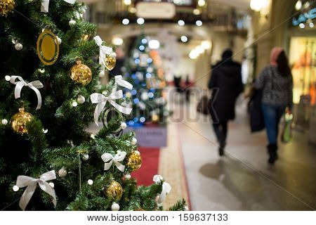 Christmas tree on background of people walking in mall