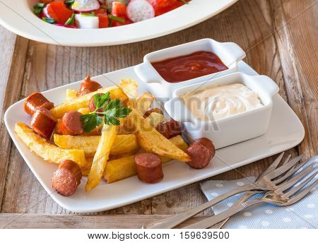 Salchipapas is a fast food dish from Latin America sold in the streets of Lima Peru and Colombia Bolivia andEcuador.