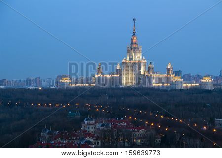 Moscow State University and guest houses of Federal Security Service on Sparrow Hills at evening - one of Stalin skyscrapers at night, MSU building was built in 1953