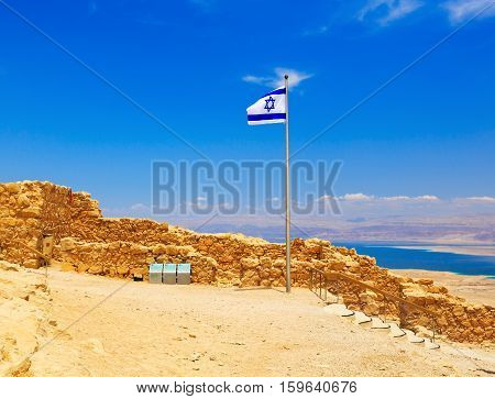 view of Israel flag in fortress Masada Israel