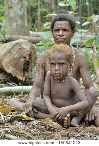 Wild Jungle, Irian Jaya, New Guinea, Indonesia - May 19, 2016: Papuan Woman And Little Boy Of Korowa