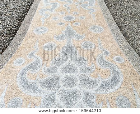 Modern art pattern on the floor at white temple in Thailand.