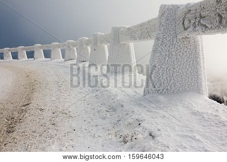 Snowy road in winter at Czech highlands