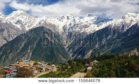 Beautiful view of Kalpa village 2960 m and Kinnaur Kailash sacred peak 6050 m at sunrise. Sangla Valley.