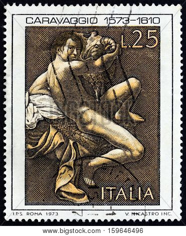 ITALY - CIRCA 1973: A stamp printed in Italy issued for the 400th anniversary of the birth of Caravaggio shows St. John the Baptist by Caravaggio, circa 1973.