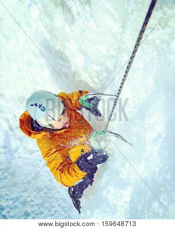 Man climbing frozen waterfall,Ice climbing the North Caucasus.