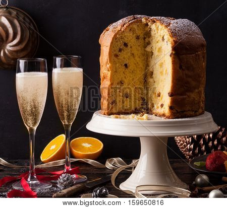 Italian panettone Christmas cake with sparkling wine prosecco or champagne.