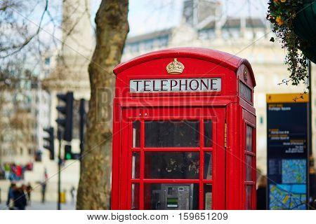 Single red phone box London United Kingdom