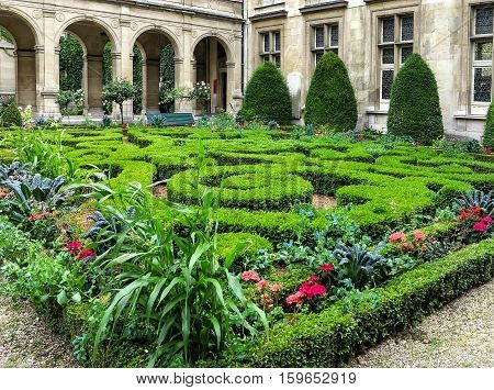 PARIS, FRANCE-JULY 29, 2016:  Paris- The Musée Carnavalet. Patio with beautiful gardens. The museum was opened in 1880 and is dedicated to the history of Paris, from its origins to the present day.