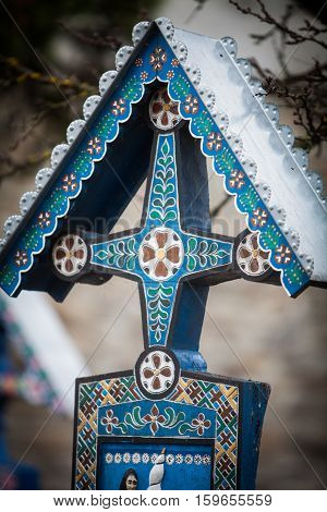 Image of a traditional painted cross in Sapanta Romania in a graveyard called
