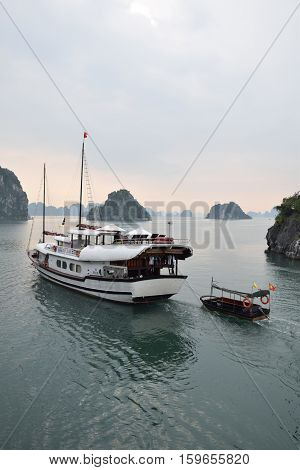 HALONG BAY, VIETNAM - SEPTEMBER 16, 2016 - Tourist junks in Halong bay