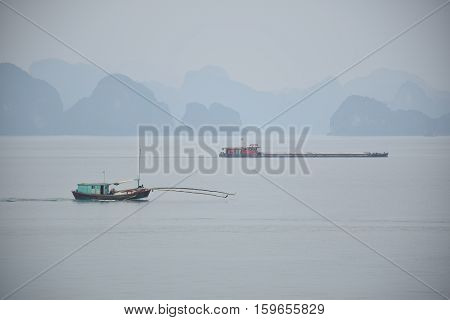 Limestone karsts and boats in Halong bay, Vietnam