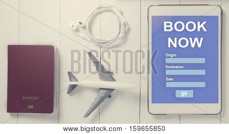 Online Travel booking on Tablet. Traveller using online travel agency to book accommodation. Online hotel booking website template on tablet screen. Hotel online reservation service on a tablet.