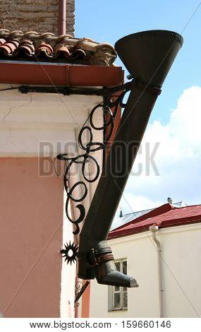 Closeup of a decorative boot-shaped drainpipe. Tallinn Estonia