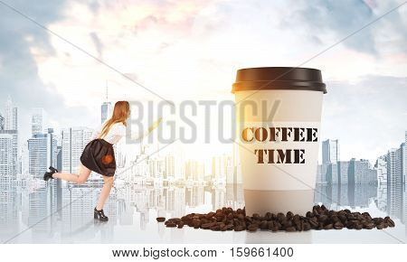 Side view of a girl running to a giant cup of coffee standing in coffee beans against a morning megapolis panorama. Toned image. Mock up