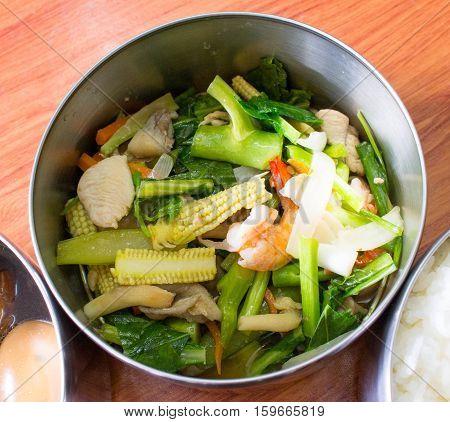 Stir-fried mixed vegetables in oyster saucein a part of food carrier thai stlyetiffnlauch jar.