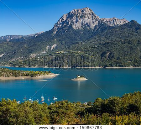View of the Grand Morgon peak (Pic de Morgon) on Summer afternoon. The Saint Michel Bay (with the Chapel) and Serre Poncon Lake. Hautes Alpes Southern French Alps France