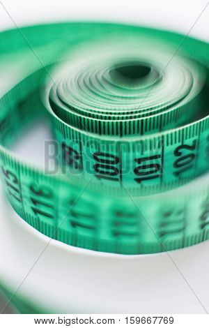 green measuring tape of the tailor, macro