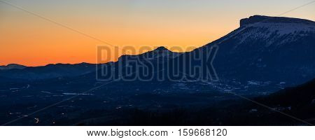 Panoramic winter sunset view of the mountains of Ceuse (also known as Céuze or Céuse) and Céuzette (Petite Céuze). Hautes Alpes Southen French Alps France